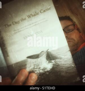 Selfie reading a book - Stock Image