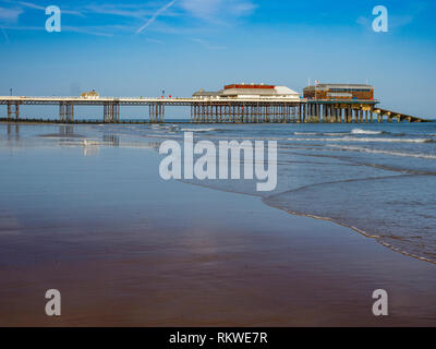 View of Cromer beach with the famous pier. - Stock Image