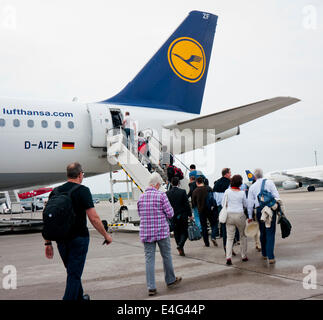 People boarding a Lufthansa jet in Germany - Stock Image