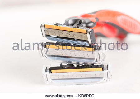 Closeup macero of shaving razor blades isolated on white background with shallow depth of view. - Stock Image