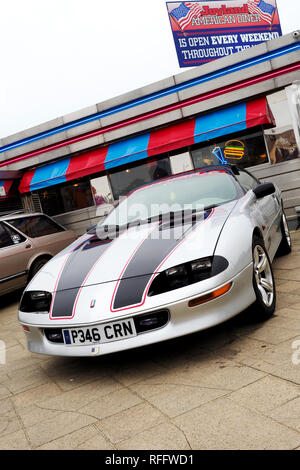 A silver fourth generation Chevrolet Camaro sports coupe from the late 1990's at a classic car meet in Great Yarmouth. - Stock Image