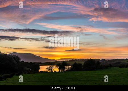 Ardara, County Donegal, Ireland. 25th March 2019. Sunset over Lake Shanaghan. Credit: Richard Wayman/Alamy Live News - Stock Image