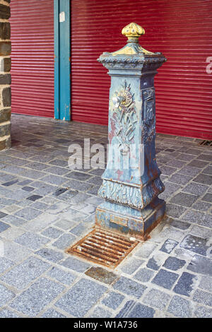 A cast iron water tap in Fougères town, Brittany, France - Stock Image