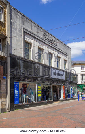 Art Deco Burton clothes shop in the shopping centre of High Street, Abergavenny, Monmouthshire, Wales, UK - summer. - Stock Image