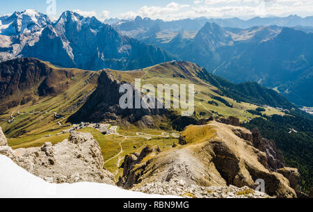Marmolada massif, Dolomiti, northern Itay. Looking down onto the Pass Pordoi in the Dolomites on a beautiful autumnal day. - Stock Image