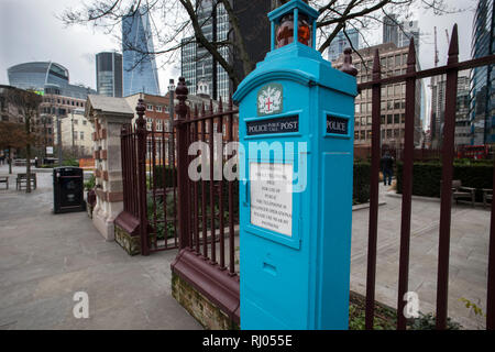 Police Call Box or Police Call Post outside St Boltolph's Church at Aldgate, just outside the actual City limits. Feb 2019 Now no longer used by Polic - Stock Image