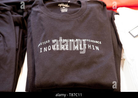 A t shirt advising people not to judge the wearer by his or her appearance. For sale at Phluid, a gender-free store in Greenwich Village, NYC. - Stock Image