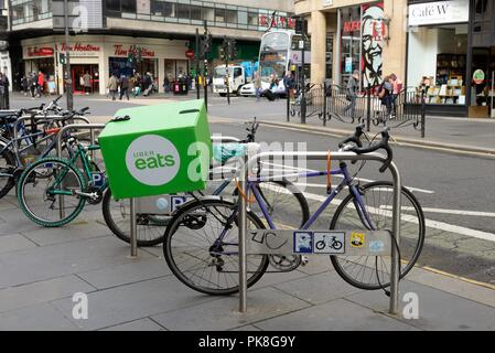 An Uber eats bicycle securely locked-up in Glasgow city centre, Scotland, UK - Stock Image