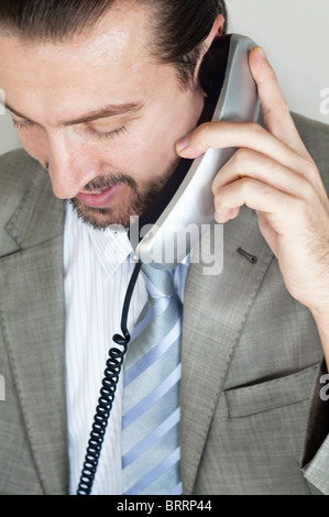 Businessmen talking on the phone - Stock Image
