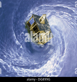 residential single family house spinning in whirlpool - Stock Image