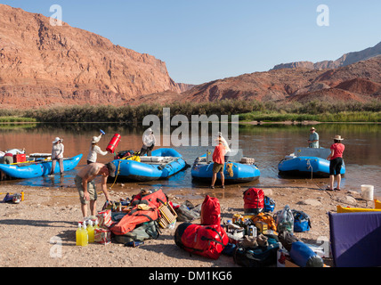 A group load and prepare their inflatable rafts at the beginning of a Grand Canyon rafting trip at Lee's Ferry, Arizona. - Stock Image