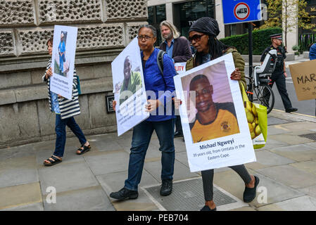 London, UK. 13th August 2018. Three days before the 6th anniversary of the massacre when 34 striking miners were shot dead by South African police at Lonmin's Marikana platinum mine, a tour of the City of London visited investors, insurers and shareholders profiting from the violence against people and nature in Marikana and heard about the colonial roots of the huge wealth of the City. Credit: Peter Marshall/Alamy Live News - Stock Image