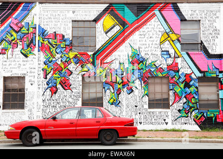 Buick Skylark parked in front of graffiti wall on West Cary street in Richmond, Virgina. Mural painted over the - Stock Image