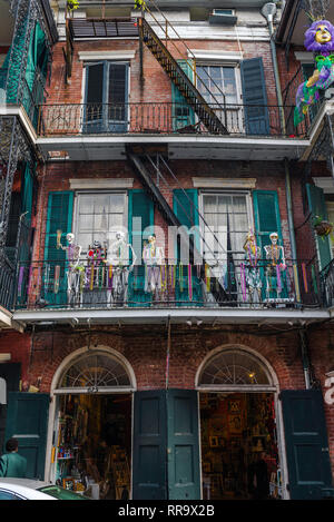 French Quarter Mardi Gras,view of skeletons and colorful throws (beads) decorating a balcony during Mardi Gras in the French Quarter, New Orleans, USA - Stock Image