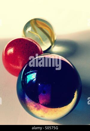 Coloured Marbles in Sunlight. - Stock Image