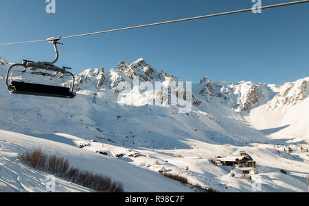 Chairlift Biollay in Courchevel 1850 looking towards La Saulire highest mountain point in Courchevel Valley ski resort 3 Valleys France French Alps - Stock Image