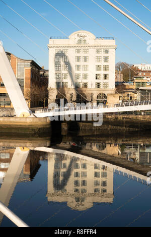 Newcastle Malmaison hotel framed by the millenium bridge and reflected in the river Tyne, north east England, UK - Stock Image