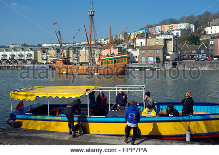 Bristol Floating Harbour - the replica Matthew sailing ship lurks in the background as a Bristol Ferryboats service - Stock Image