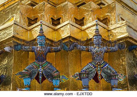 Temple of the Emerald Buddha - Wat Phra Kaew - in Bangkok (Thailand) : demon guards (yaksha) - Stock Image