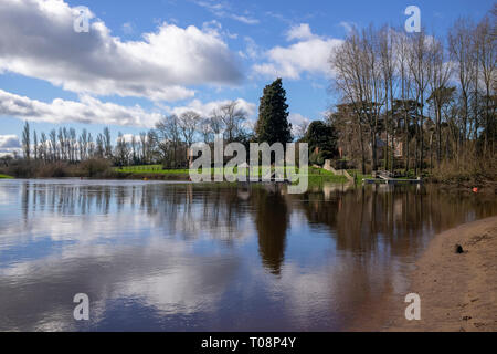 Cumulus clouds reflected in the basin formed at the confluence of the rivers Nidd and Ouse, Nun Monkton, North Yorkshire, UK - Stock Image