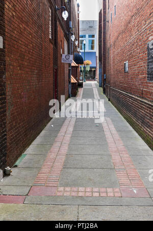JOHNSON CITY, TN, USA-9/30/18: A neatly paved alley/walkway, off Main St. - Stock Image