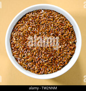 Bowl of Natural Haelthy Brown Linseeds High in Protein and Fibre - Stock Image