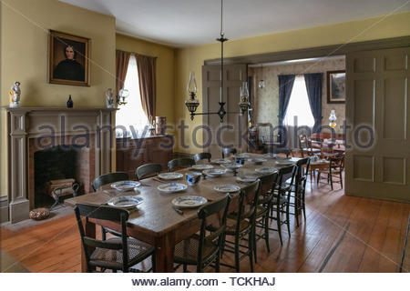Toronto, Canada-May 30, 2019: The dining room and furniture inside of the Half Way House. The image is taken in the Black Creek Pioneer Village which  - Stock Image