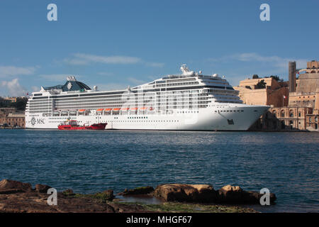 The cruise ship or liner MSC Orchestra in Malta's Grand Harbour. Mediterranean cruises. - Stock Image