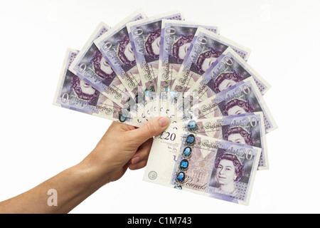 Fan of Twenty Pound Notes with Hand - Stock Image