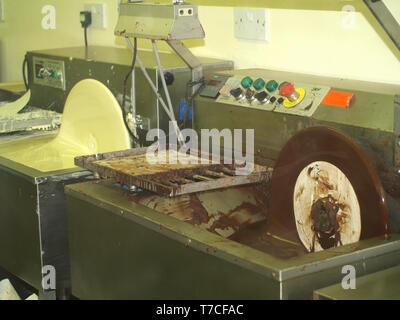 Chocolate making machinery at The Chocolate Workshop at Beaulieu, New Forest, Hampshire, England, UK - Stock Image