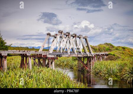 The disused wooden railway bridge crossing Mahinapua Creek near Hokitika, on the New Zealand South Island's West coast. - Stock Image