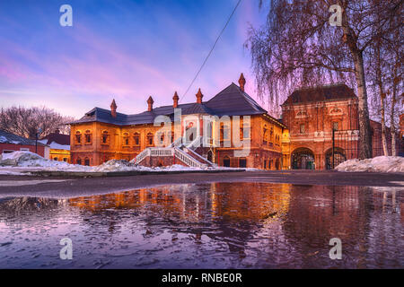 Krutitsy Patriarchal Metochion at sunset reflecting in puddle, Moscow, Russia (HDR image) - Stock Image