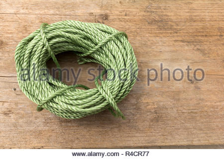 Ball of green garden twine - Stock Image