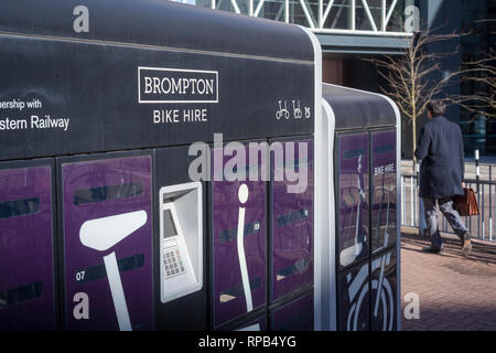 A Brompton Bike Hire outside Reading Station, Berkshire. - Stock Image