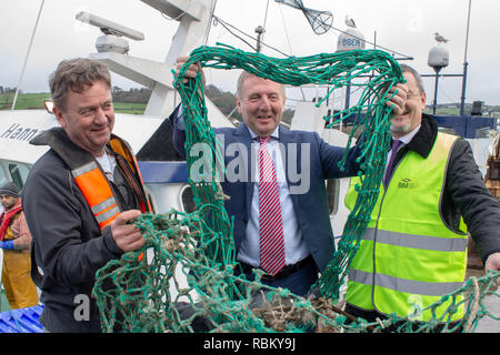 Union Hall, West Cork, Ireland, January 11th 2019 Michael Creed TD Minister for Agriculture, Food and the Marine visited Union Hall today to launch his new anti pollution and plastic recovery initiative. Fishermen will be able to land plastic waste and old fishing net to a central point on the quay, where it can be collected for recycling and proper disposal at a later date.  Credit: aphperspective/Alamy Live News - Stock Image