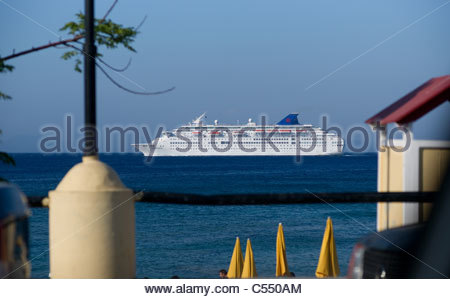 Cruise ship off the coast of Rhodes Island Greece - Stock Image