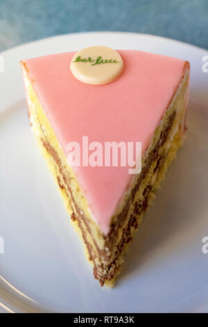 A slice of the famous Torta Rosa (Pink Cake) at Bar Luce, Wes Anderson-inspired bar and cafe in the Fondazione Prada district of Milan, Italy - Stock Image