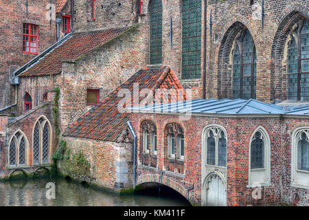 Detail of the old hospital building, people used to be able to arrive by boat via the canals - Stock Image