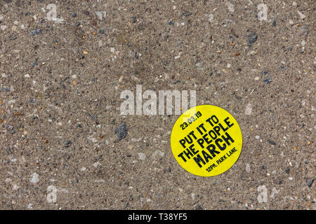 Put It to the People March - an anti Brexit sticker on the pavement from the 23rd March 2019 - Stock Image