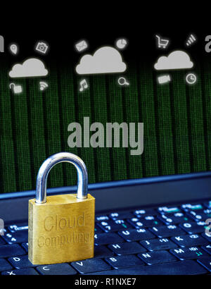 Golden padlock on computer laptop keyboard with Cloud Computing icons and binary data. Concept of Internet security, data privacy, cybercrime preventi - Stock Image