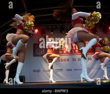 San Francisco 49er Goldrush cheerleaders perform during the NFL rally at Trafalgar Square, London on October 30, - Stock Image