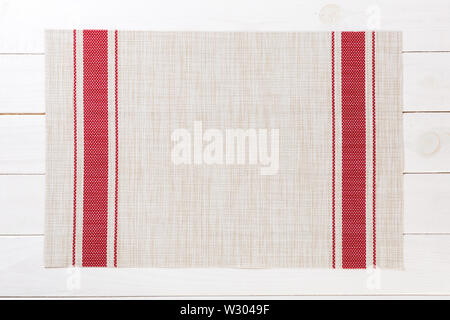 Tablecloth textile on wooden background top view with copy space. - Stock Image