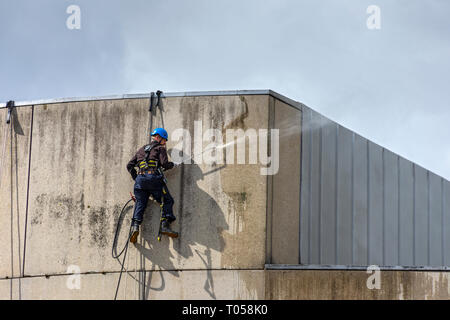 Rope access workers power washing the Scottish Parliament Building, Holyrood, Edinburgh, Scotland, UK - Stock Image