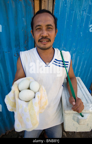 A Filipino Balutan displays a selection of his baluts, or cooked fertilized duck eggs, in Oriental Mindoro, Philippines. - Stock Image