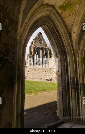 The ruins of Valle Crucis Abbey viewed from the chantry. Founded as a Cistercian monastery in 1201 and closed in 1537 - Stock Image