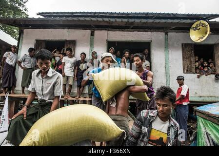 Humanitarian aid supplies are delivered by an NGO to flood hit communities in Myanmar's Irrawaddy delta region. - Stock Image