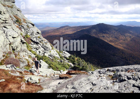 Man hiking the Long Trail near the summit of Camel's Hump, VT, USA - Stock Image