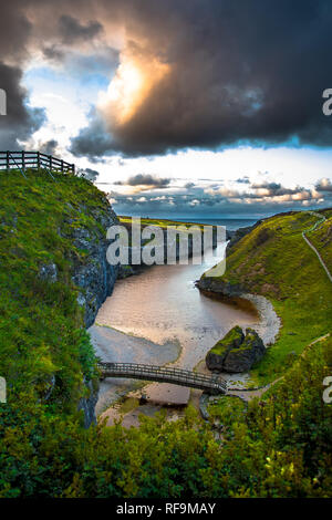 Canyon And Entrance To Smoo Cave And Atlantic Coast At Sunset Near Durness In Scotland - Stock Image
