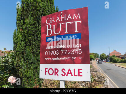 For sale sign from Graham Butt estate agents in West Sussex, UK. British house for sale sign. - Stock Image