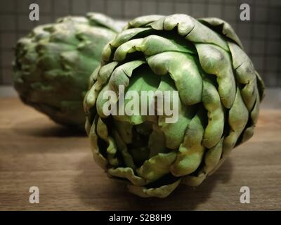 Ripe green artichoke vegetable - Stock Image